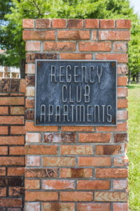 regency club apartments outdoor sign