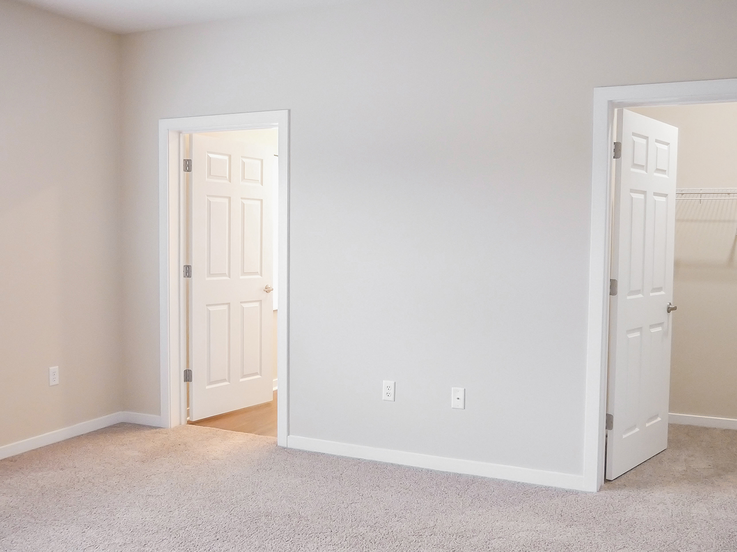 bedroom with closet and bath